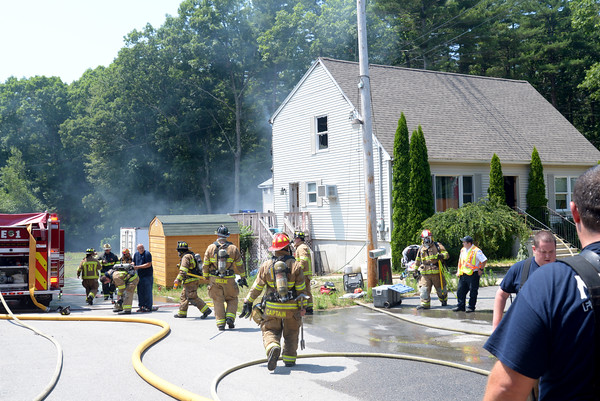 JIM VAIKNORAS/Staff photo Emergency response personal at fire on CCC road in Salisbury.
