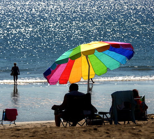 JIM VAIKNORAS/staff photo Sunshine sparkles off the water at Salisbury Beach on a hot July Saturday. Tempuratures are expected to stay near 90 the next few days.