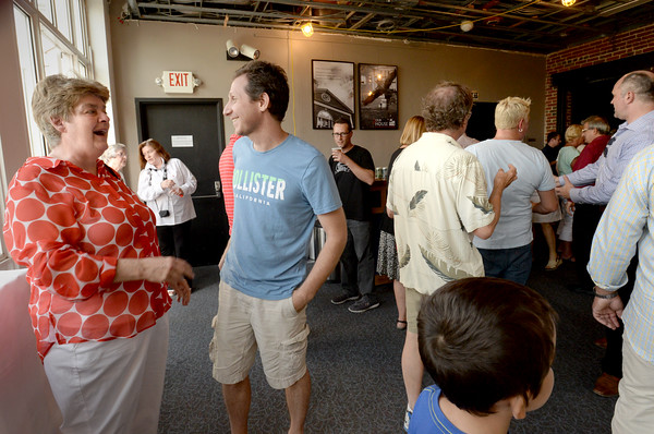 BRYAN EATON/Staff photo. Abraham's Bagel owner Linda Garcia greets Beto Cesca and the scores of people who came to the fundraiser at the Firehouse Center on Wednesday night.