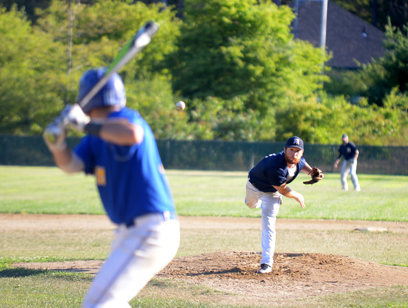 JIM VAIKNORAS/Staff photo Manchester's Peter Clark throws against Rowley during their game at Eiras Field in Rowley.