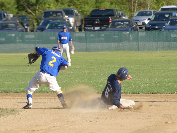 JIM VAIKNORAS/Staff photo Manchester's Cole Josslyn steals second as the throw gets away from Rowley's CJ Ingraham during their game at Eiras Field in Rowley.