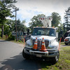 BRYAN EATON/Staff photo. Utility trucks were numerous as crews worked to restore electricity in the area around Lake Attitash in Amesbury.