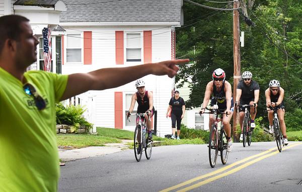 BRYAN EATON/Staff photo. Bikers are directed to the parking lot of Lake Gardner Beach to begin their running leg of the DAM Sprint Triathlon.