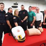 BRYAN EATON/Staff photo. The Merrimac Fire Department has purchased a Lucas 3 chest compression system, at left of mannequin, with donations from the community and major donors. From left, f ...