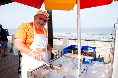 JIM VAIKNORAS/Staff photo Charlie Labella serves his Monstah Dawgs on the new boardwalk on Salisbury Beach.