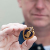JIM VAIKNORAS/Staff photo Donny Lavalley holds his grandfathers recently found Purple Heart