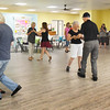 BRYAN EATON/Staff photo. A dozen people showed up for ballroom dancing lessons yesterday at the Hilton Senior Center in Salisbury.