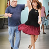 BRYAN EATON/Staff photo. Ballroom dance teacher Ivana Ruzkova shows Paul Johnson how to twirl a partner during classes at the Hilton Senior Center in Salisbury on Wednesday morning.