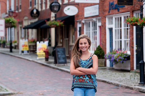 JIM VAIKNORAS/Staff photo Singer Cate Mangione poses in Market Square in Newburyport, she will be performing during Yankee Homecoming.