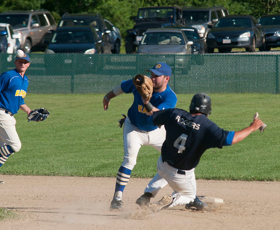 JIM VAIKNORAS/Staff photo Rowley's Anthony Conte waits for the ball before tagging out a Manchester runner as he attempts to steal 2nd during their game at Eiras Field in Rowley Wednesday.