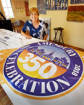 BRYAN EATON/Staff photo. Artist Sandra Morrissey with the Amesbury 350th logo.