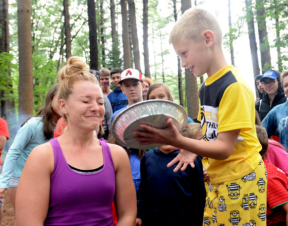 BRYAN EATON/Staff photo. Camp counselor Heidi Hansen prepares as Harrison Amaral, 9, delivers a whipped cream pie to her face at the Camp Kent Nature Center in Amesbury where several programs for the Amesbury Youth Services are held. It's tradition that if a camper has a birthday while at camp, they get to deliver a pie to the CIT or counselor of their choice.