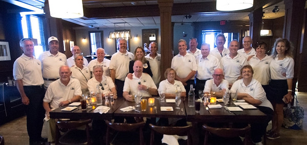 JIM VAIKNORAS/Staff photo Past and present Yankee Homecoming Chairman pose for a photo during their annual luncheon at the Mission Grill Sunday afternoon..