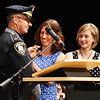 BRYAN EATON/Staff photo. New Amesbury police chief William Scholtz as his wife Kim and daughter, Ally, pin on his badge.