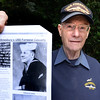 BRYAN EATON/Staff photo. Henry Cross with a photo of Amesbury native William Justin who was killed on the USS Forrestal during the Vietnam Conflict.