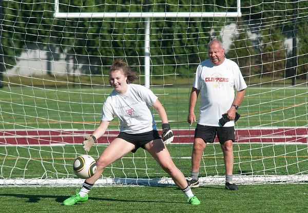 JIM VAIKNORAS/Staff photo Lillly Donavan, class of 2014, makes a stop with her high school coach Robb Gonnam with he during the Newburyport Girls Soccer Alumni Games at World War Memorial Stadium Sunday.