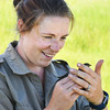 BRYAN EATON/Staff photo. Biologist Bri Benvenuti of the Rachael Carson National Wildlife Refuge in Maine holds a saltmarsh sparrow that's already been banded.