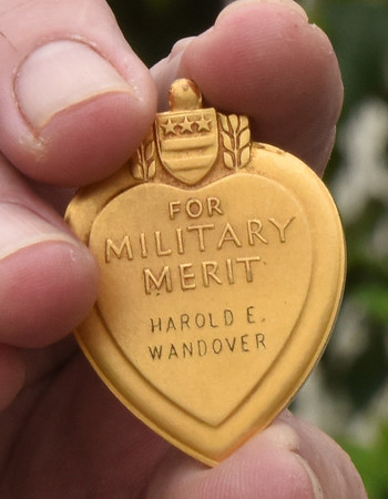 BRYAN EATON/Staff photo. Tom Fowler picked up this purple heart of Harold E. Wandover that  he picked up at a flea market at the Sullivan Building in Newburyport.