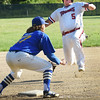 BRYAN EATON/Staff photo. Rowley Rams third baseman Colby Ingraham gets the throw late allowing the Rockport player to safely make the base.