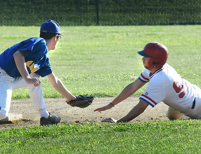 BRYAN EATON/Staff photo. Rowley Rams second baseman Dylan Copeland tags out Rockport's 93 on a steal attempt.