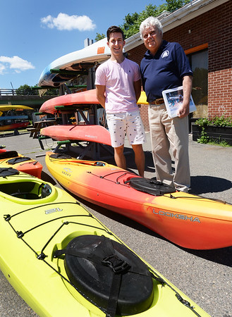 BRYAN EATON/Staff photo. Larry Wielgos, right, with Plum Island Kayak guide Heath King, is chair of a kayak and paddleboard event to raise money for Yankee Homecoming.