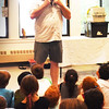 BRYAN EATON/Staff photo. With a packed house at the Heritage Towers' club room in Amesbury, Rick Roth of Creature Teachers describes the life of a kinkajou which is on his shoulder. His presentation of different animals, part of the Amesbury Public Library's Kids' Summer Reading program, was sponsored by Friends of the Library and the Amesbury Housing Authority.