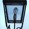 BRYAN EATON/Staff photo. What could be a house finch, and its mate out of view, kept bringing pieces of grass up into this lamp post on State Street in Newburyport on Monday afternoon. They had no luck as the pieces kept falling to the sidewalk below as there was really nothing for them establish a holding.