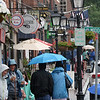 BRYAN EATON/Staff photo. Umbrellas and rain coats were the order of the day Friday as seen on State Street in Newburyport. Today the weather should improve with Sunday being the best of the weekend with sun and drier weather.