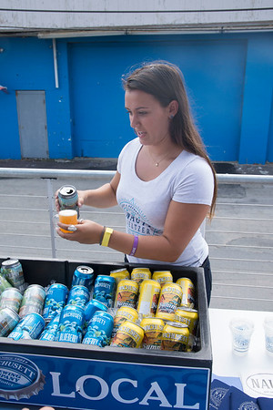 JIM VAIKNORAS/Staff photo Skylar Alves of Wachusett Brewing Company pours a beer at the Salisbury Beach Brew Fest. Proceed from the event benefited the Parks and Recreation Commission and the Boys and Girls Club of Lower Merrimack Valley.The the lineup included Wachusett Brewing Company, Nauti Seltzer, Goose Island, Downeast Cider House, Allagash Brewing Company, Shock Top & Blue Point Brewery.