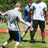 BRYAN EATON/Staff photo. Pittsburgh Steelers player Terrell Watson works with kids on agility.