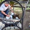 BRYAN EATON/File photo. Dave Leonard put cobblestones under benches at Atwood Park in the South End in August of 2015, part of renovations to the park in Newburyport's South End.