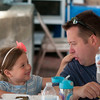 JIM VAIKNORAS/Staff photo Annasophia Sykes, 5, of Amesbury and her dad Keith enjoy lamb and stuffed grape leaves at the Greek Food Festival Friday at the Annunciation Greek Orthodox Church on Harris Street in Newburyport.