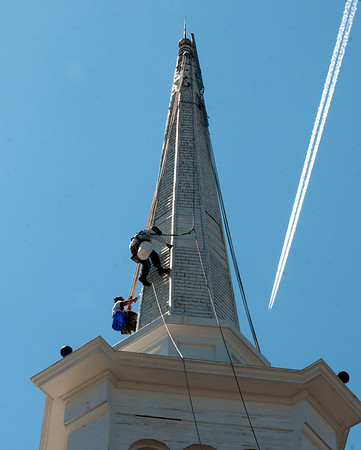 JIM VAIKNORAS/Staff photo Workers from American Steeple and Tower in Salem Ma. work on the steeple at teh Central Congregational Church in Newburyport Wednesday morning.