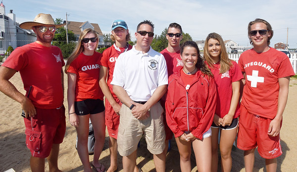 BRYAN EATON/Staff photo. Newburyport lifeguards assigned to a recent shift flank harbormaster Paul Hogg, from left, Drew Brewer, Rebecca Kench, Jake Greco, Hogg,  Matthew Hayden, Grace Shelley, Abbie Thurlow and Cam Smith.