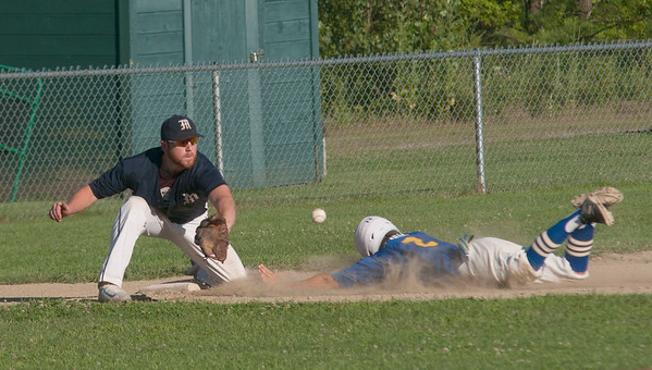 JIM VAIKNORAS/Staff photo Rowley's CJ Ingraham dives into 3rd just a head of the ball during the Ram's game against Manchester at Eiras Field in Rowley Wednesday.