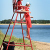 BRYAN EATON/Staff photo. Newburyport lifeguards Grace Shelley, top, and Jake Greco take up their positions on the northeast side of Plum Island Point along the Merrimack River at the start of one of their recent shifts.
