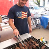 JIM VAIKNORAS/Staff photo Niko Baifsas, who is visiting from Greece grilles lamb at the Greek Food Festival Friday at the Annunciation Greek Orthodox Church on Harris Street in Newburyport.