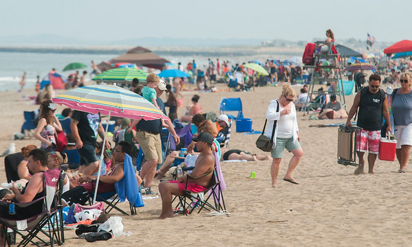 JIM VAIKNORAS/Staff photo People and umbrellas crowd Salisbury Beach on a beautiful July weekend.