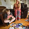 BRYAN EATON/Staff photo. Tommy Bell, 9, with mom, Colby Heywood, reads some of his many birthday cards in their Newburyport home.