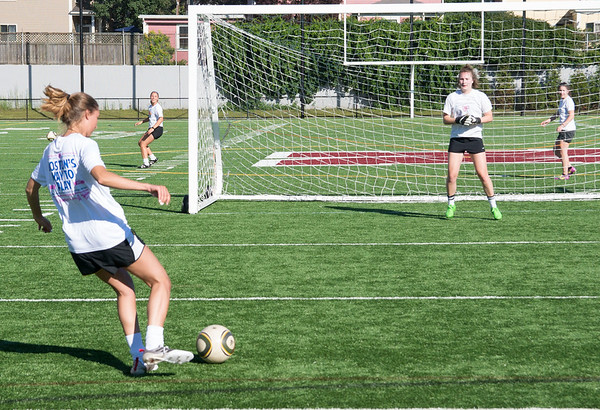 JIM VAIKNORAS/Staff photo Jill Kinter, class of 2009, takes a shot on net during the Newburyport Girls Soccer Alumni Games at World War Memorial Stadium Sunday.