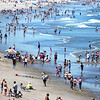 BRYAN EATON/Staff photo. With perfect weather and people taking an extra day off before the Fourth of July, Salisbury Beach was a busy spot seen from a view looking north from the second floor of the Blue Ocean Event Center. Today should be just as crowded as nice weather continues through the week.