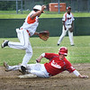 BRYAN EATON/Staff photo. Levi Burrill is forced out at second by the Beverly shortstop.