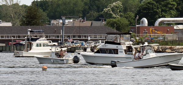 BRYAN EATON/Staff photo. There were plenty of boaters going up and down the Merrimack River, here are three in front of the American Yacht Club in a view from the pier at Ring's Island in Salisbury. The weather for boating for the rest of the holiday weekend seems good except for some showers forecast for some time on Saturday.