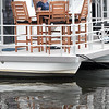BRYAN EATON/Staff Photo. Maureen Daley of Newburyport relaxes with some reading on the deck of a houseboat.