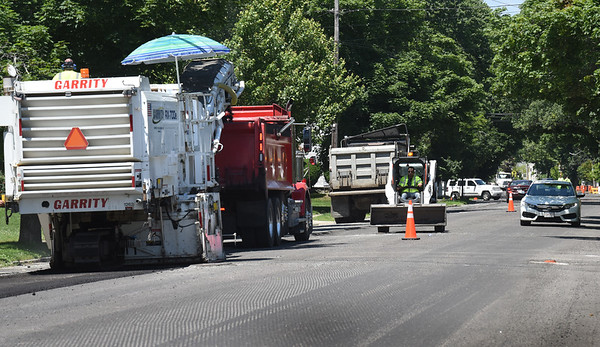 BRYAN EATON/Staff Photo. Traffic was down to one lane of travel as crews continued to scrape up old the roadbed into a dump truck Tuesday morning. The work on the repaving project goes from Three Roads east to Winter Street near the Route One overpass.