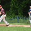 BRYAN EATON/Staff photo. Newburyport first baseman Brady Ford has the ball forcing out Nate Giguere.
