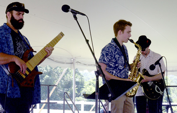 BRYAN EATON/Staff Photo. The Chuck Walker Trio were entertaining under the big tent at the West Newbury Bicentennial Field Day at Pipestave Hill on Saturday.