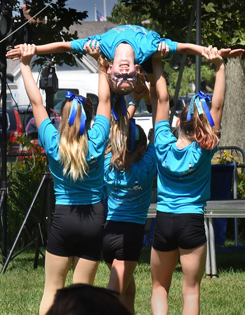 BRYAN EATON/Staff Photo. Youngsters from Kadee's Tumbleweed also perform some gymnastics in their dance moves.