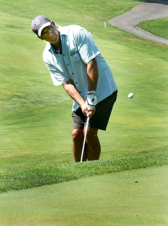 BRYAN EATON/Staff Photo. Mitchell O'Meara of Newburyport pops the up to the green.