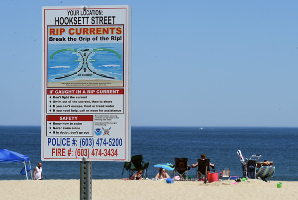 BRYAN EATON/Staff Photo. Signs warning of rip currents have been posted at access points to the beach at Seabrook.